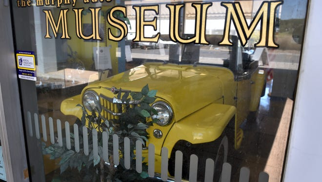 A 1949 Willys Overland Jeepster sits at the entrance to the Murphy Auto Museum in Oxnard.