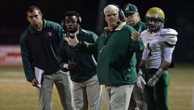 Acadiana head coach Robert Davidson gestures after a call against the Rams during their Class 5A second round playoff game against Parkway.