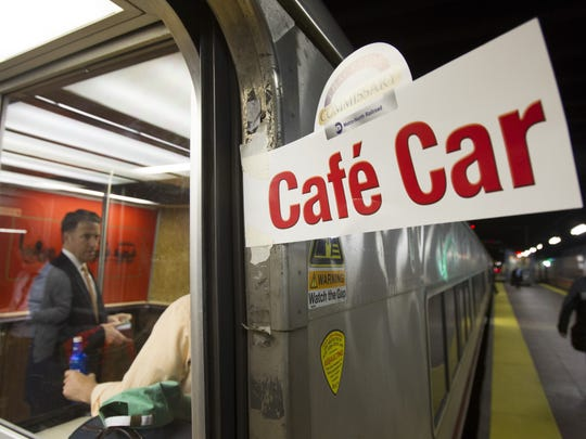 A sign posted on a Metro-North car in 2014 directs riders to the bar car on the 7:07 p.m. train to New Haven, Connecticut.