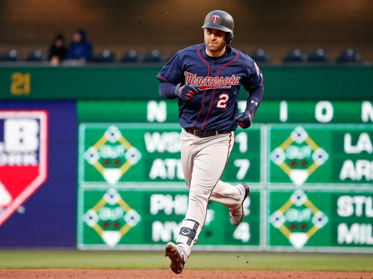 Minnesota Twins' Brian Dozier rounds second after hitting a solo home run off Pittsburgh Pirates starting pitcher Ivan Nova during the third inning of a baseball game in Pittsburgh, Wednesday, April 4, 2018. (AP Photo/Gene J. Puskar)