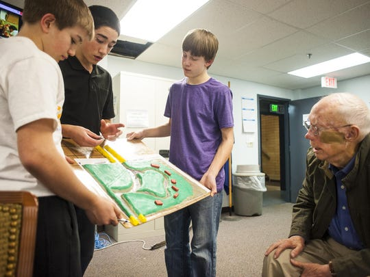 In 2016, Lewistown junior high Geographic Information Systems students, left to right, Collin Comes, Sam Fulbright and Ryker Melton show Jack Stone their model of where Big Spring Creek cut through his field in the 2011 flood. The students entered their creek cleanup project in a national Samsung Solve for Tomorrow contest and were the statewide winners. In fact, the school has won three of the last four years.