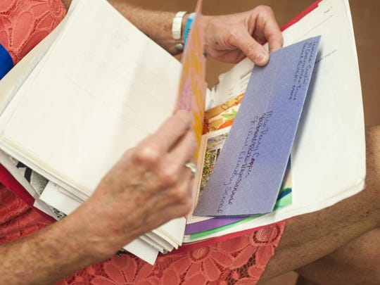 Penny Cooper shows her Feel Good File, a collection of notes from her 29-year career, on her last first day of school at Meadow Lark Elementary Wednesday morning.