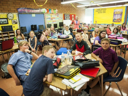 Penny Cooper and her 6th grade class on their first day of school at Meadow Lark Elementary Wednesday morning.