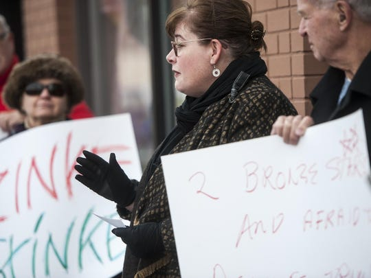 Sandi Filipowicz, YWCA executive director, speaks at a protest by Montanans Rally for Women asking Congressman Ryan Zinke to withdraw his endorsement of Donald Trump outside of Zinke's office on Central Avenue on Tuesday.