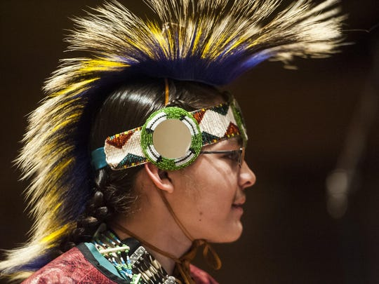Peter Gil, a Great Falls High freshman, dances for the Kenny Endo Contemporary Ensemble during a cultural exchange drum circle at the Civic Center.