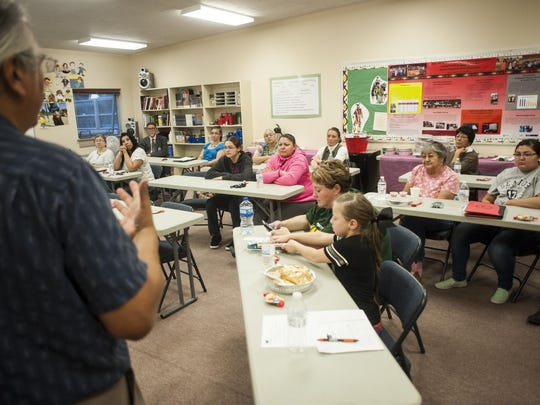 Dougan Coburn, a pre-college adviser for the Montana Educational Talent Search Program, speaks during an Indian Parents Advisory Committee meeting at the Paris Gibson Education Center on Tuesday.