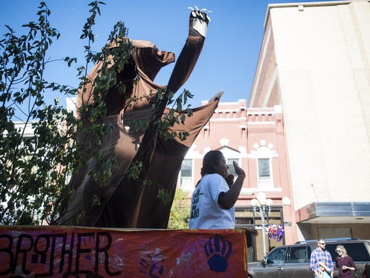 The American Indian Club float rolls down Central Avenue