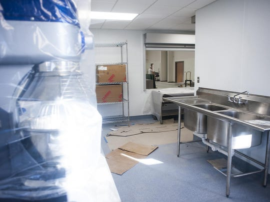 Commercial kitchen equipment is being installed at