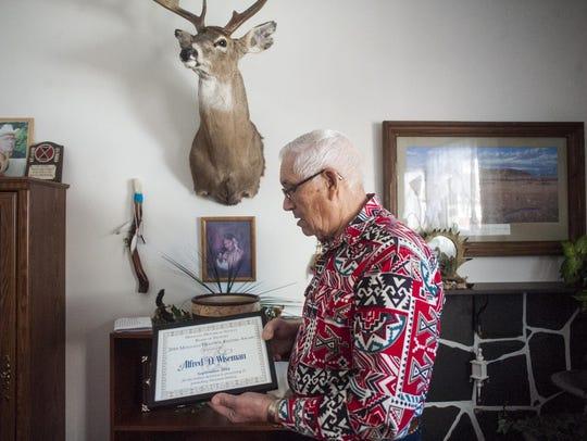 Al Wiseman holds his Trustees Heritage Keeper Award