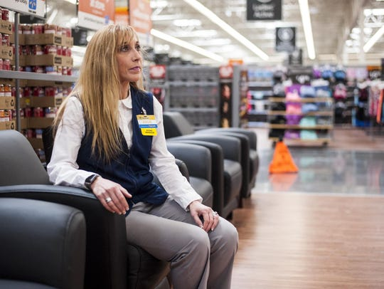 Store manager Angie Powell sits in the online order pickup waiting area at Great Falls' new east-side Wal-Mart.