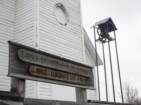 Sacred Heart Church's original bell hangs before the Holy Cross Catholic Church in Dupuyer. This bell will be moved back to the Belgian Colony Church and will be replaced with a steel bell Mike Habets bought from Craigslist.