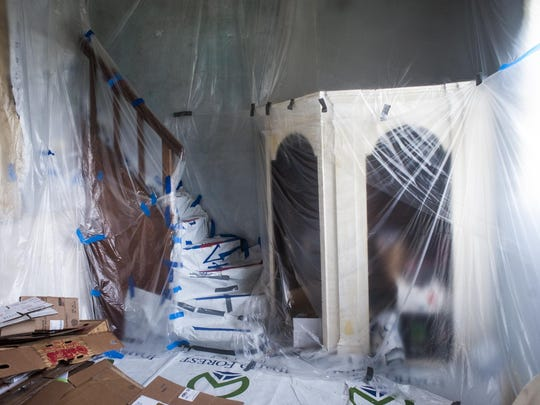 Plastic covers the Sacred Heart Church's interior to protect the repaired plaster and refinished wood.