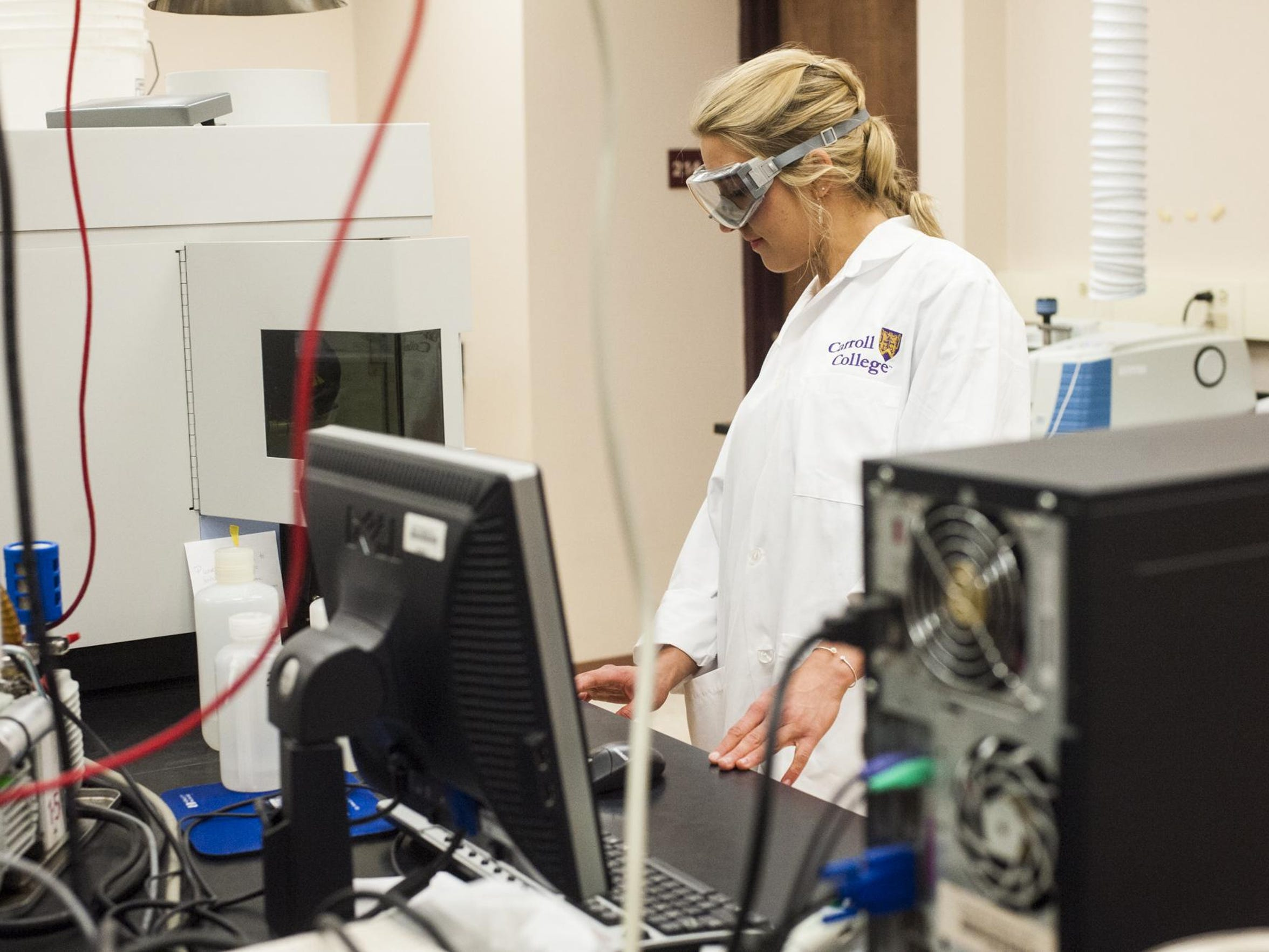 Lauren Rhoda completes a lab assignment as part of her major in chemistry at Carroll College on March 23.