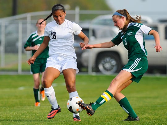 Sussex Tech forward Michelle Laz battles against Indian River defender Sarah Buchler during a game last season. Buchler has moved to the midfield for the upcoming season as the Indians defend their Henlopen crown.