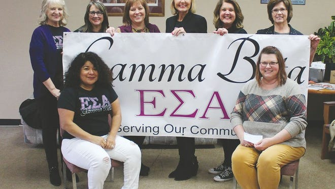 Taking part in a special donation ceremony last week in Pratt were Gamma Beta members (from left) Anel Cox (seated) Gamma Beta President, Linda Broce, Bekki Pribil, Laverne Taylor, Debbie Estes, Kelly Richardson, Jeri Mitchell and Pamela Ford (seated) Director of the Hope Center.