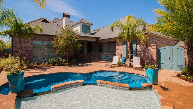 The pool and spa create a relaxing oasis in the backyard.