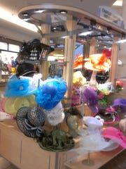 Some of the many Derby hats Danielle DeLaine designs for the Kentucky Derby each year. This is the first year DeLaine has been designing hats full-time. Last-minute customers have always purchased the last remaining Derby hats from her shelves, so this year she has tried to keep pace with demand.