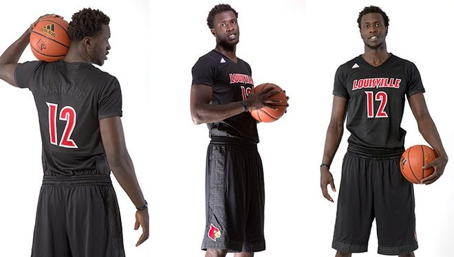 "Mangok Mathiang shows off U of L's ""Black Ice"" uniforms to be worn Nov. 28."