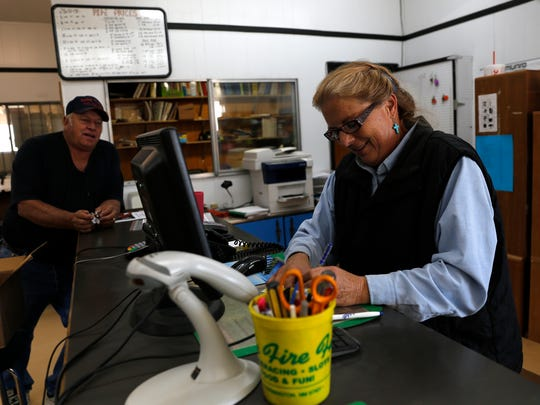 Kim Martinez helps customer Mark Bailey, owner of Bailey Drilling, Thursday at Basin Pump and Supply in Bloomfield.