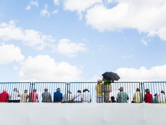 Spectators watch from the grandstands on the 18th hole as golfers begin to finish during the final day of the Chubb Classic in Naples last year.