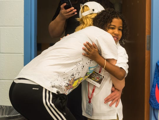 Winslow kindergartner Zayden Bernabe gets a hug from