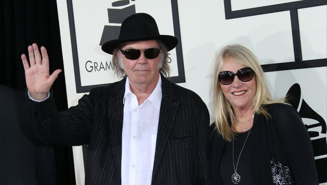 Neil Young and Pegi Young arrive at the 56th Annual Grammy Awards