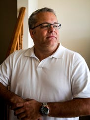 Derek Weimer poses for a portrait in his home Sunday,