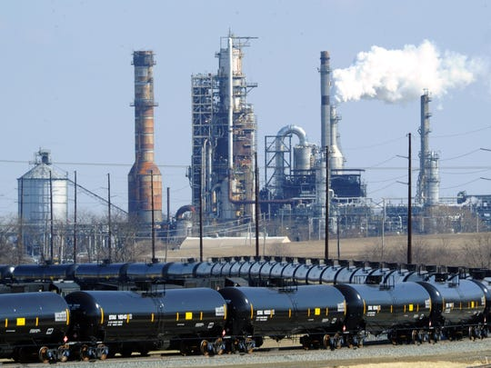 Train cars sit outside the Delaware City Refinery on March 12, 2013.