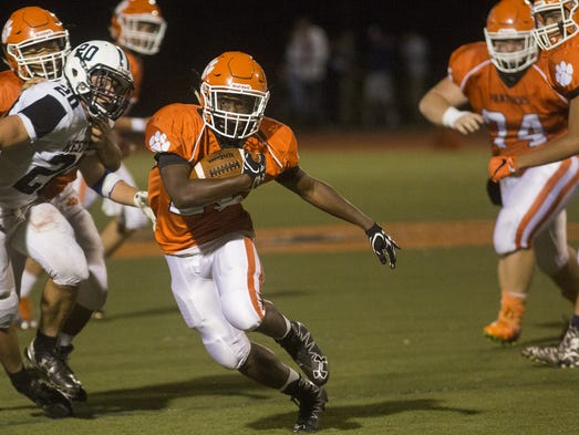 Central York's Chris Collins runs with the ball. Central