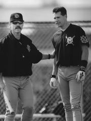 Bill Spiers (right), shown with manager Phil Garner, played for the Brewers from 1989-'94.