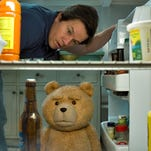 "In this image released by Universal Pictures, the character Ted, voiced by Seth MacFarlane, bottom, and Mark Wahlberg appear in a scene from ""Ted 2."""