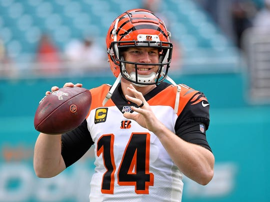 Dec 22, 2019; Miami Gardens, Florida, USA; Cincinnati Bengals quarterback Andy Dalton (14) warms up before a game against the Miami Dolphins at Hard Rock Stadium. Mandatory Credit: Steve Mitchell-USA TODAY Sports