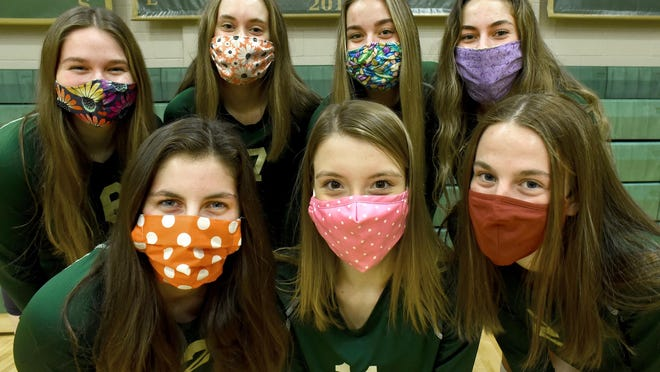 SMCC seniors (front row from left) Jaydin Nowak, Grace Lipford, Anna Dean and (back from left) Olivia Anderson, Kylie Barron, Mikayla Haut, and Abbie Costlow have a little fun with different color mask before a recent practice.