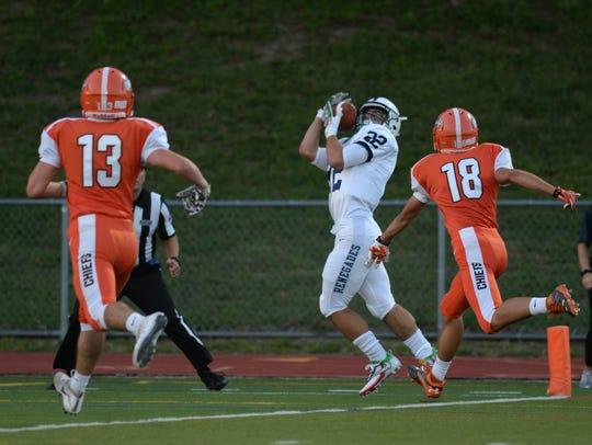 Shawnee's Ryan Parris catches a touchdown pass against