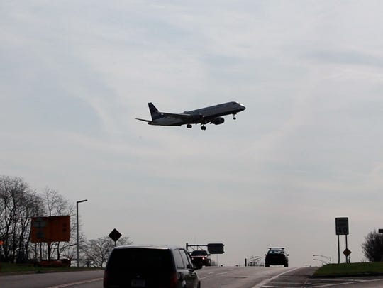 A Jet Blue airlines plane lands at Greater Rochester