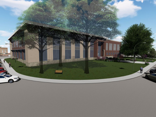 Drawings of what the new Warren County Courthouse could look like if voters approve the new building August 7 show a building with large windows surrounded by trees.