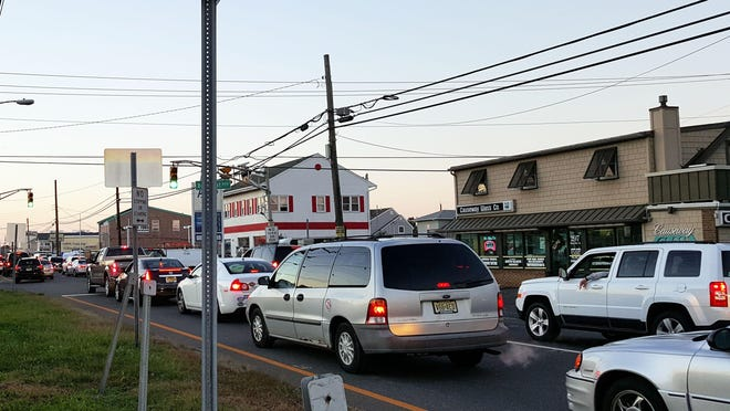 Cars wait, bumper to bumper, to leave Ship Bottom following the Christmas Parade on Saturday.