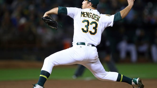 Oakland Athletics pitcher Daniel Mengden works against the New York Yankees in the fourth inning of a baseball game Tuesday, Sept. 4, 2018, in Oakland, Calif. (AP Photo/Ben Margot)