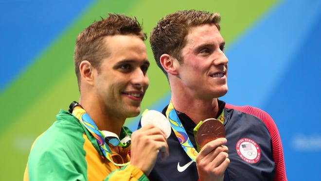 Conor Dwyer (USA) and Chad le Clos (RSA) pose with their medals after the men's 200 freestyle final during the Rio 2016 Summer Olympic Games at Olympic Aquatics Stadium on Aug. 8.