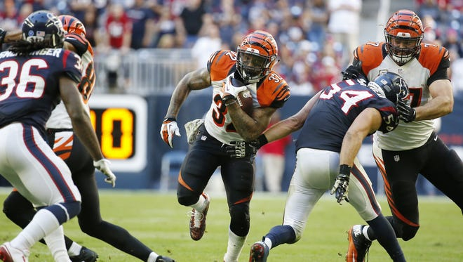 Bengals running back Jeremy Hill runs the ball in the fourth quarter against the Texans at NRG Stadium.