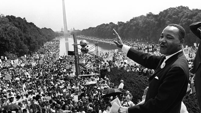 "Civil rights leader Martin Luther King waves to supporters Aug. 28, 1963, on the Mall in Washington, D.C., during the March on Washington. King called the march ""the greatest demonstration of freedom in the history of the United States."""