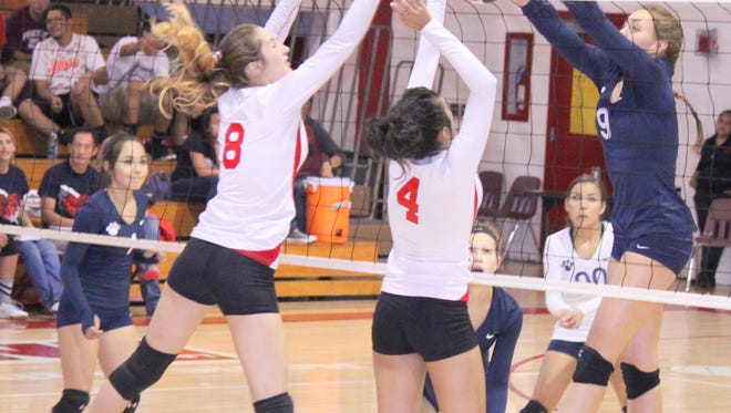 Deming's Amanda Borden  (9) meets a few Cobre blockers at the net. She led the Lady Wildcats in kills, as Deming picked up a road win Thursday night in Bayard.