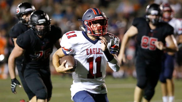 Eastchester quarterback Marc Cacciola runs with the ball in a football game against Rye Sept. 23, 2016 at Rye High School.