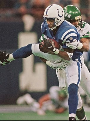 Indianapolis Colts defensive back Ray Buchanan intercepts a pass in front of the New York Jets' Jeff Graham during a game at the RCA Dome.
