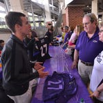 Ravens fans speak with a uniform authenticator during the Ray Rice jersey exchange Friday at M&T Bank Stadium. Fans were allowed to swap the jerseys for another player's jersey.
