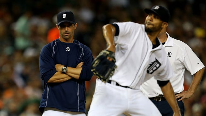 Detroit Tigers manager Brad Ausmus watches David Price throw before taking him out of the game during the seventh inning against the Kansas City Royals on Friday, May 8,2015 at Comerica park in Detroit.