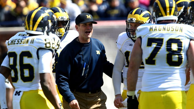 Michigan head football coach Jim Harbaugh coaches the Maize team during the Michigan spring football game April 4, 2015.