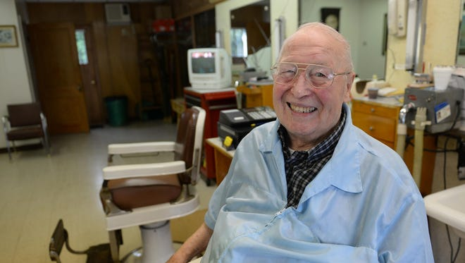 86-year-old Robert Brien sits in his 1920s-era barber chair at his shop at 120 Allouez Ave. After barbering for 60 years, Brien is preparing to hang up his clippers and retire.