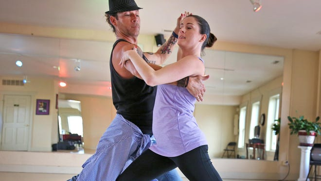 "Leslie Bailey rehearses with instructor Darren Cupp, at Darren's Ballroom Dancing, in Carmel, Wednesday, November 4, 2015. They prepare to compete in ""Shall we dance? Indy Stars Dance for DK."" The competition, a fundraiser for Dance Kaleidoscope, will be at Park Tudor on November 15, 2015."