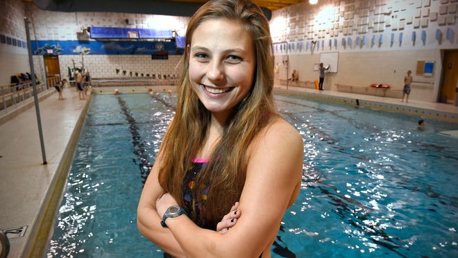 Senior Meghan Mokhtary stands Tuesday, Nov. 17, next to the Holdingford High School pool. Mokhtary will compete in the state girls swimming tournament this weekend after winning the Section 6A 100-yard breaststroke title.